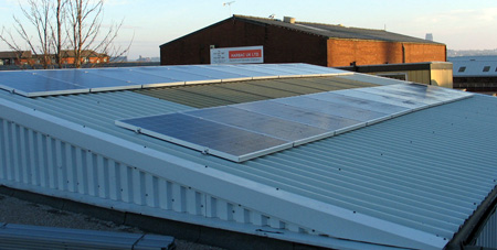 Solar PV panels on warehouse roof - Universal Lighting Services Ltd
