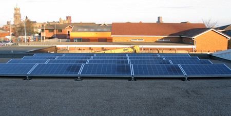 Solar PV panels on showroom roof - Universal Lighting Services Ltd