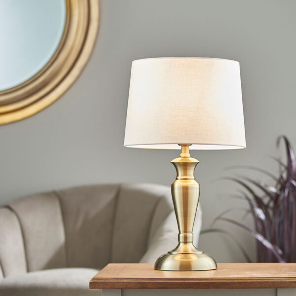 Oslo medium traditional table lamp in antique brass white linen shade roomset