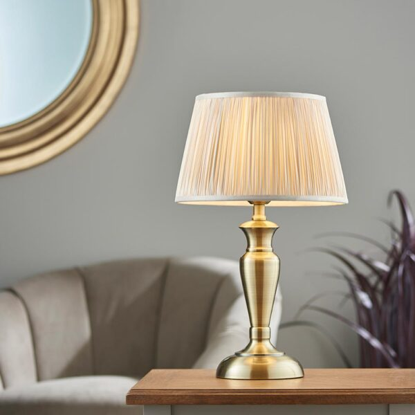 Oslo medium traditional table lamp in antique brass oyster silk shade roomset