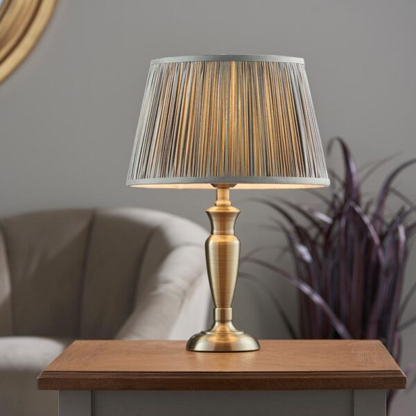 Oslo small traditional table lamp in antique brass grey silk shade roomset