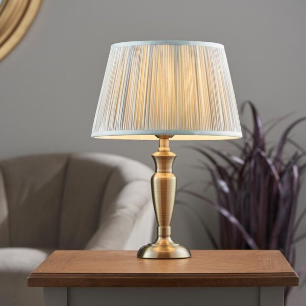 Oslo small traditional table lamp in antique brass silver silk shade roomset