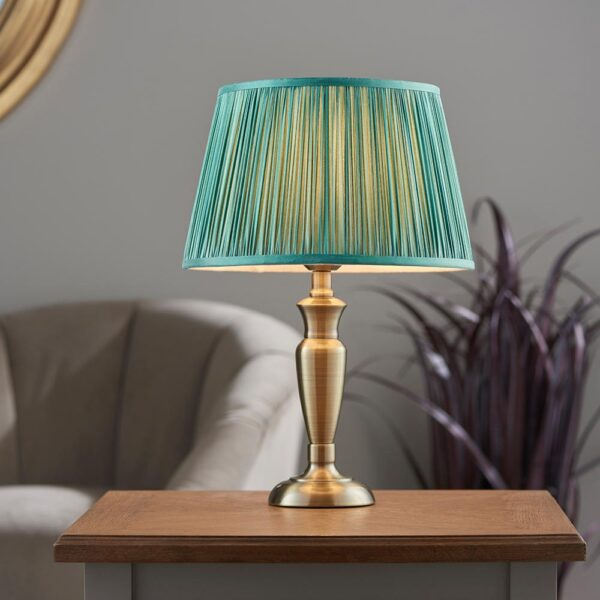 Oslo small traditional table lamp in antique brass fir silk shade roomset